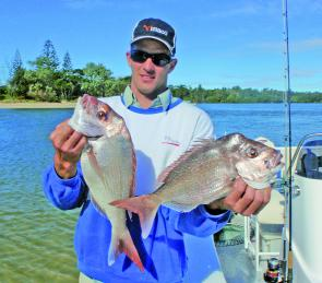 Lucas Green with a couple of snapper caught off Sandon River. Now's a good time for the reds.