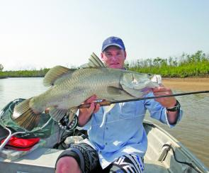 Scott Kampe with a neat saltwater barra.