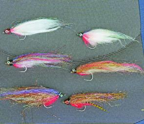 Upsizing is the way to go with barra. These rough looking flies are all tied on 4/0 hooks.
