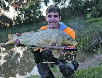 Jordan Cervenjak with a typical urban lake carp on the fly.