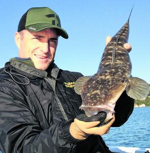 The author with a solid flathead caught by methodically working the deeper holes and channels.