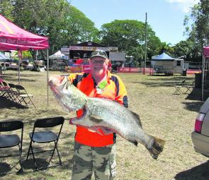 Weigh master Terry Walters with a 15.75kg barra caught on a live bait at Point Vernon by Damian Paranitti of Hervey Bay. The fish took out the runner up heaviest fish prize and best fish prize on the Friday of the comp and the $1,000 prize for best fish o