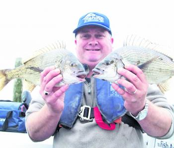 The author with a brace of Curdies bream taken just outside the river mouth in the lake on a greyback minnow.