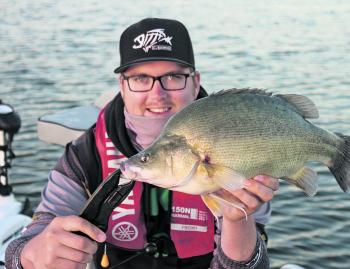 Brad Penna with the winning target species, a 54cm golden perch.