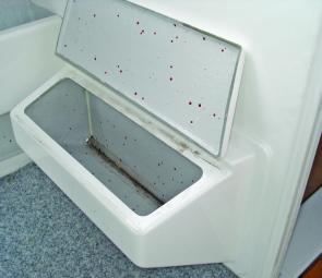 The footrests are put to full use by having a hinged lid to offer two handy storage compartments.