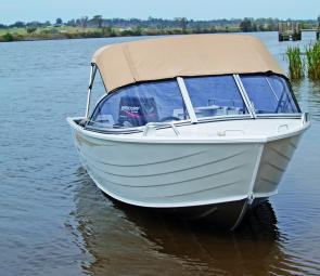 The standard canopy features a zip-back section to allow the skipper and mate to stand and look over the three-piece windshield.
