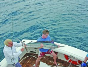 The Barmy Army about to release a black marlin caught while they were on tour.