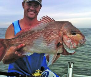 Andrew Badullovich with another quality red. The snapper will be more likely be offshore this month, rather than off the rocks.