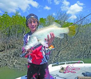 Keen young angler Luke Vella with a lovely salty barra from the mangroves.