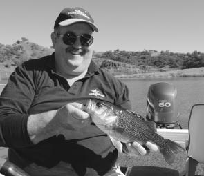 Mick Mee with a nice bass caught in deeper water after the sun drove the fish from the shallows.