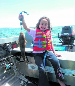 Young Ava showing her dad how to catch a nice Lake Mac flathead. Her smile says it all.