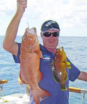 Peter, Skipper of the charter boat Lady N, shows that having two hooks pays off when coral trout are around North West Island.