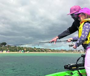 Easter on the water is all about introducing kids to fishing. The author's daughter, Summer, is putting the finishing touches to one of 3 squid she landed out from Fishies Beach, Mornington.