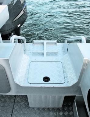 Every inch of this boat has a purpose, which is seen here with the live bait tank doubling as a step into the boat.