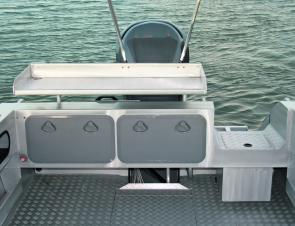 The transom boasts two large storage areas, a bait board and rod holders.