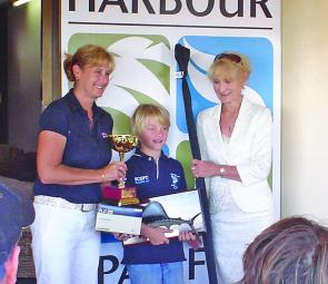 Daniel Brooks receiving one of many trophies from the Bribie Island Tournament.