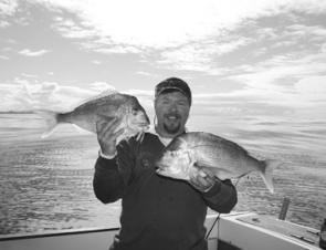 Good quality reds like these two caught by the author have made most inshore fishos smile over the cooler months.