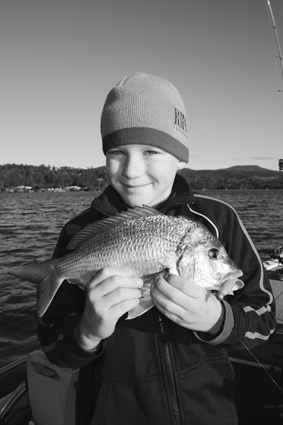 Tom Griffiths, 9, with his first bream on a lure.