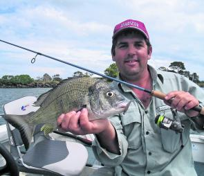 Throwing soft plastics in tight to structure can result in bream like this.