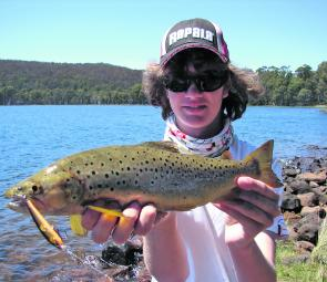 Nathan Huizing with a beautiful Bronte Lagoon brown trout.