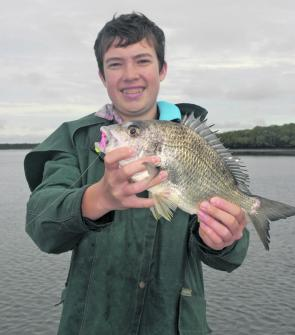 Young Stuart Grice with a lovely big bream on a plastic.