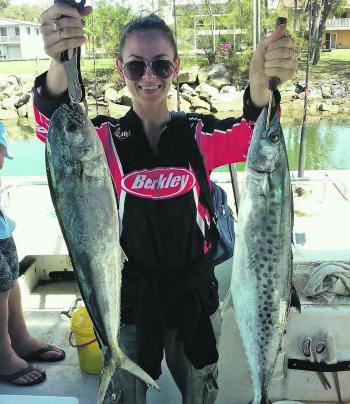 This angler is happy with her mahimahi and spotty.