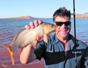 Brett Corker loves his fishing, and he is good at it too! Here is he with a Lake Hume carp caught on a 40mm Metalhead soft plastic while targeting redfin recently. The redfin and carp should both be quite active in Lake Hume during April.