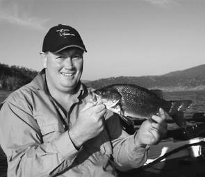 Chris Ingle with one of the last surface-sippers of the season, caught on a Heddon Tiny Torpedo.