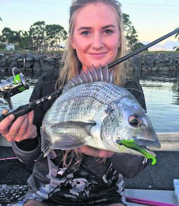 Taylor Egan with a bream caught on an Atomic Prong.
