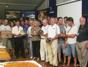 Teams from the Newcastle and Port Stephens Game Fish Club celebrate their overall win in the tag-and-release category of the NSW Interclub tournament.