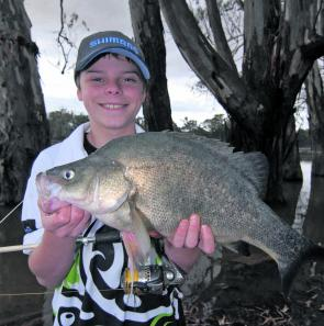 Jock Mackenzie with some ripper golden perch caught fishing the shallows with worms.
