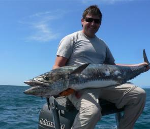 Southern visitor Michael Sas was more than pleased with this fine Spanish mackerel he caught recently while fishing out of Cairns with Kerry Bailey.