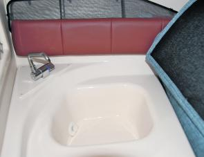 Family anglers will enjoy the fresh water sink within the Grady White's cuddy cab.