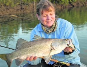A fat little Lenthalls Dam barra taken on fly by Denise Kampe.