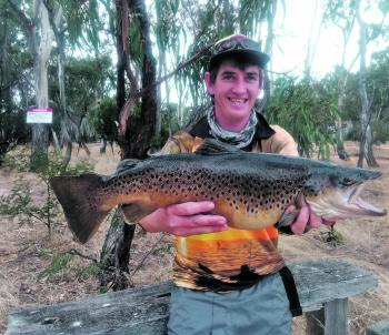 Jarrod Woolley proves you don't need a big lure to trick a big trout. This 5.5lb beast was caught on a 4cm Rapala lure.