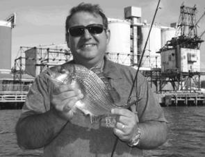 Peter Jack with a wharf-dwelling bream persuaded to leave its home.