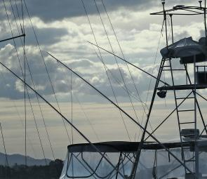 A centre rigger is often run from very high up on boats with towers, the idea is often to have the centre rigger clip higher than the outrigger clips when all the lines are in their fishing position.