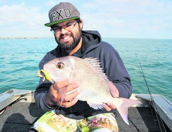 Safwaan Ismail with a nice pan-sized snapper. Fish like this are great fun on the light gear and love soft plastics.