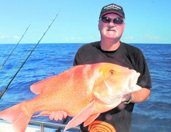 Steve with a solid red emperor, which fell to a saltwater fly.