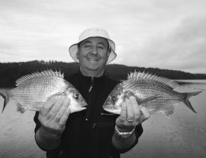 Quality bream like this pair of 700g fish will school up in the deeper water this month. Concentrate your efforts in the lower sections of the estuary.