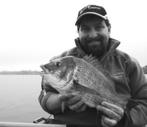 Author with a 4lb, 46cm bream ready for release, caught on a hard-bodied lure.