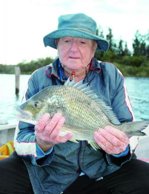 Merv Wright with a lovely Forster bream taken on a soft plastic at a floating oyster rack. Fortunately the fish swam straight out, away from the line-shredding structure.