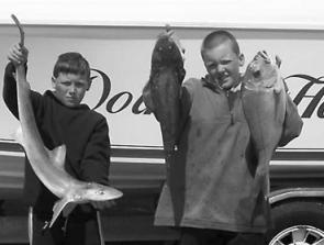 The Savage boys, Brenton and Brandon, from Doin It Hard with their catch.