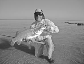 Catching a nice salty barra like this is what heading north is all about. The author landed this one off a Gulf beach.