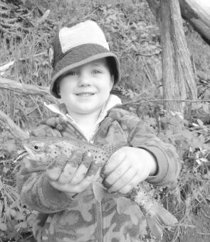 Lochie holds up a lovely brown trout caught in low water in Traralgon. It required the use of a TT 1/60oz lead free jig head with a cut down ginger beer Berkley power minnow.