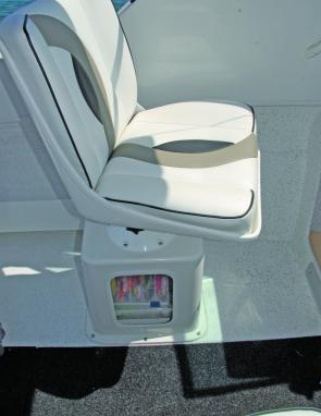 Storage boxes under forward seating made sense, the tackle trays under the mate's seat an example of the use the space could be put to.