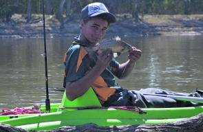 Tyson Smythe with a small silver perch he caught bait fishing near Wemen. These fish are a constant annoyance to bait anglers.