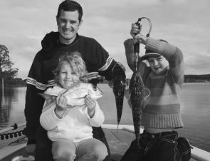 Andrew Munro and his daughters Ella, 5, and Bree, 7, with a couple of flatties and snapper destined for the dinner table.