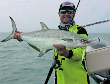 The author with a great grey mackerel on the 1516h Zillion Baitcaster.
