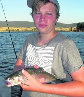 Lachlan Brittan, of Northbridge, with another Jindy rainbow trout.